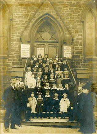 Sunday School children stand on the steps leading to the entrance doors of the chapel nd c1890 | Image from the collections of the Newcastle upon Tyne District Archives